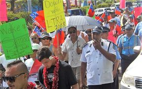 There was a heavy police presence in Apia as about 200 people turned out to protest against land laws.