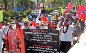 About 200 people marched through Samoa's capital, Apia, on Saturday, protesting against land laws.