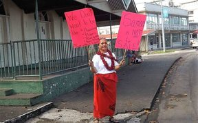 A woman protests against Samoa's land laws in Apia on Saturday.