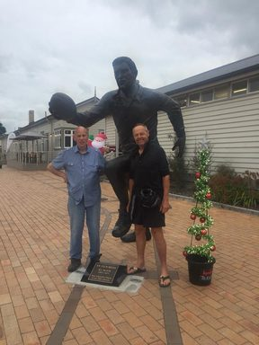 James and Bruce pose with the statue of Colin Meads in Te Kuiti.