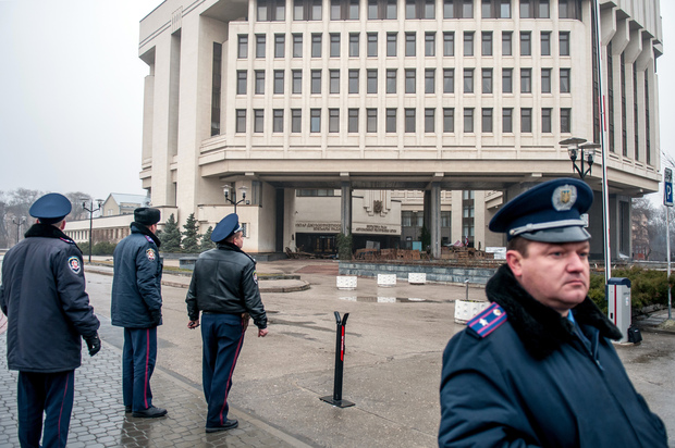 Police on guard in Simferopol after pro-Russian armed men seized the local parliament.