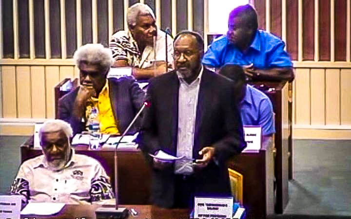 Vanuatu prime minister Charlot Salwai (standing) defends his policies during debate for a parliamentary motion of confidence tabled against him by the opposition, 19 December 2017.