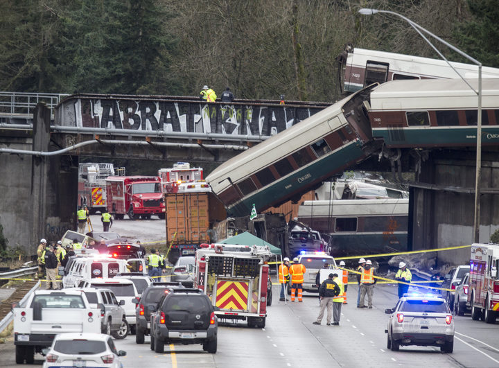 Emegency crews work at the scene of a Amtrak train derailment on December 18, 2017 in DuPont, Washington.