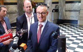 David Clark talks to media at Parliament.