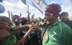 This picture taken in Dili, East Timor on July 18, 2017 shows Xanana Gusmao (R) president of CNRT (National Congress for Timorese Reconstruction) during a campaign in Dili. 