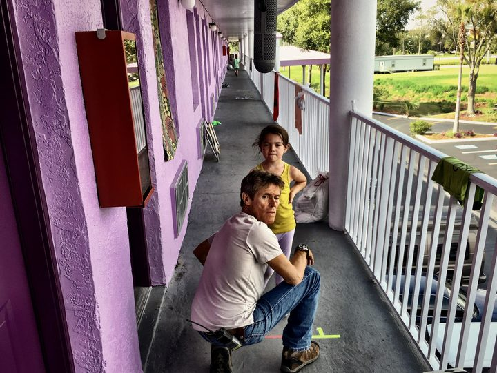 Willem Dafoe and Brooklynn Prince try to work something out in The Florida Project.