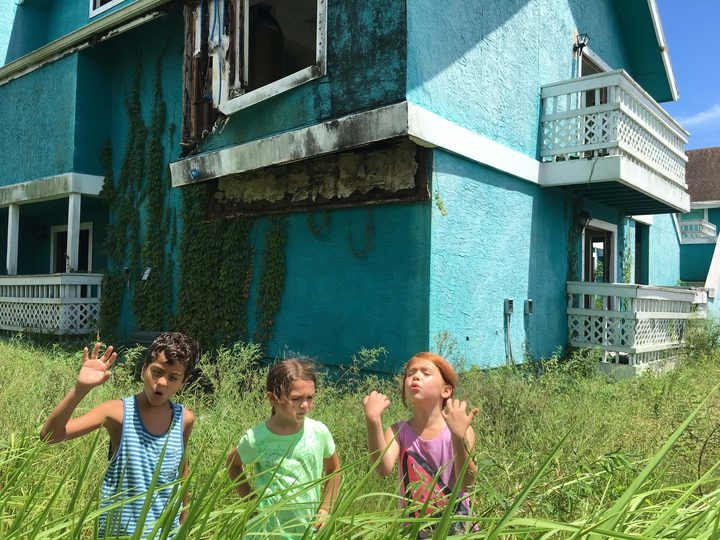 Christopher Rivera, Brooklynn Prince and Valeria Cotto explore the abandoned houses of Orlando in The Florida Project.