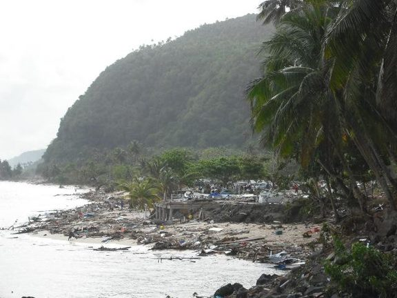 Debris strewn along the shoreline following the tsunami.