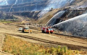 Firefighters battling a blaze at the Hazelwood open cut coal mine near Morwell.