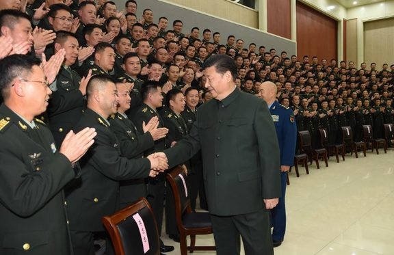 Chinese President Xi Jinping (R, front), also general secretary of the Communist Party of China (CPC) Central Committee and chairman of the Central Military Commission, meets with senior officers of the 71st Group Army of the People's Liberation Army earlier this month.
