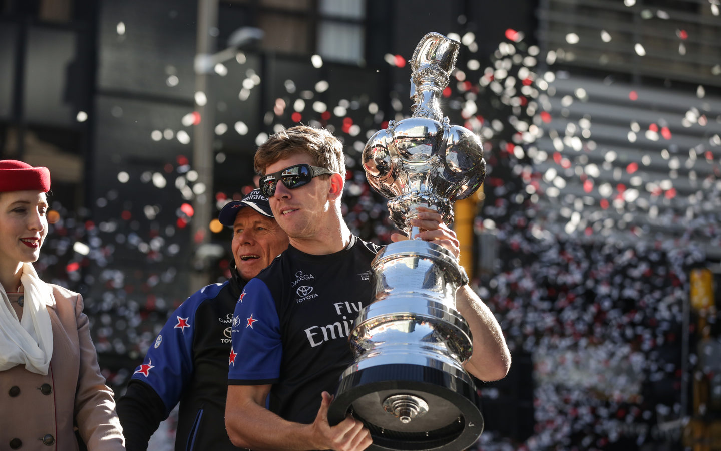 Peter Burling holds the America's Cup during the Wellington victory parade.