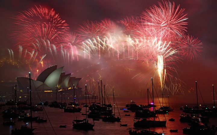 Fireworks light the sky over the Opera House and Harbour Bridge during New Year's Eve celebrations in Sydney.