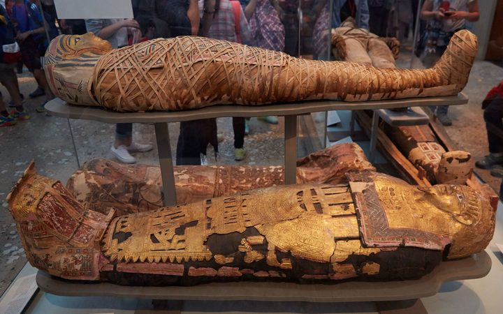 Mummies and sarcophagus in the British Museum in London.