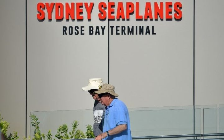 Visitors are seen at the entrance to the Sydney Seaplanes terminal in Rose Bay, Sydney on January 1, 2018.