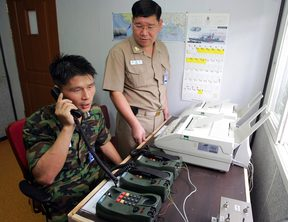 A South Korean uses the hotline to talk to North Korean officers in 2005.
