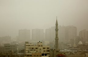 Gaza City's skyline is seen engulfed in dust as a storm hits the region.