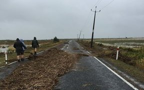 Debris cover the road in the small settlement of Kaiaua on the western side of the Firth of Thames.