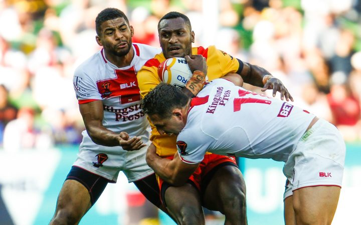 Kato Ottio gets tackled by Kallum Watkins and Sam Burgess during the England Vs Papua New Guinea 2017 Rugby League World Cup.