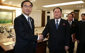 South Korea's Unification Minister Cho Myung-Gyun (L) shakes hands with North Korean chief delegate Ri Son-Gwon after their meeting at the border truce village of Panmunjom.