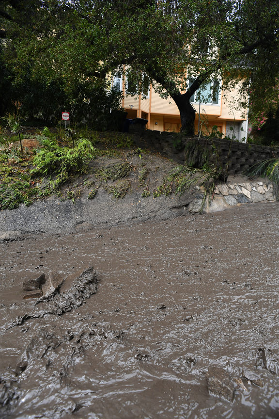 Mud fills a street after a rain-driven mudslide destroyed two cars and damaged property in a neighborhood under mandatory evacuation in Burbank, California.