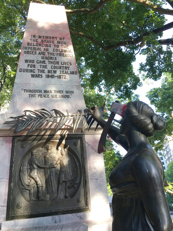 "The war memorial on the corner of Symonds Street and City Road in Auckland. A The group have attached an axe to her head and a poster to the plaque that reads: ""Fascism and White Supremacy are not Welcome Here."""