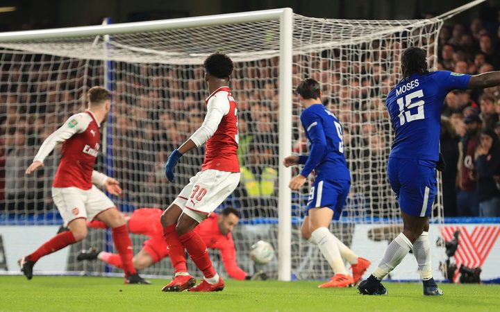 Chelsea's Victor Moses has his shot saved on the line by Arsenal goalkeeper David Ospina.