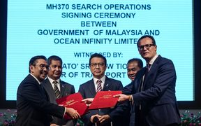 The MH370 search signing.
