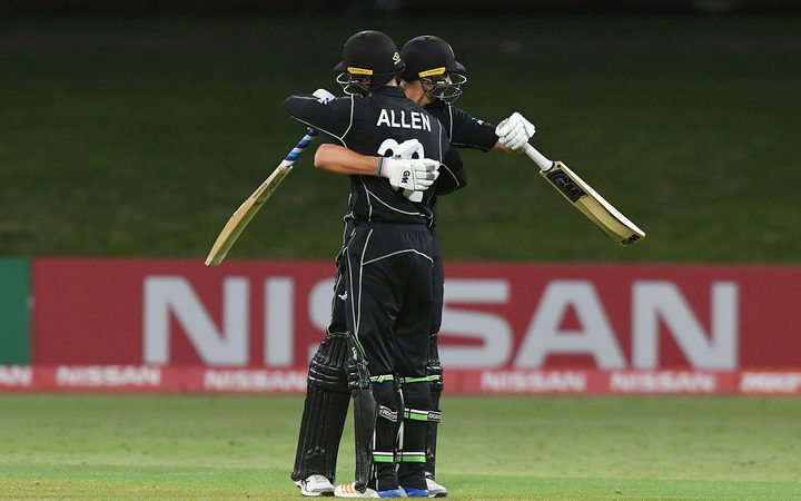 New Zealand's Finn Allen and Kaylum Boshier celebrate winning the Under 19 Cricket World Cup match against the West Indies.