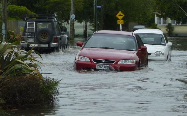 Cars struggle through floods on Matlock Street in Woolston.