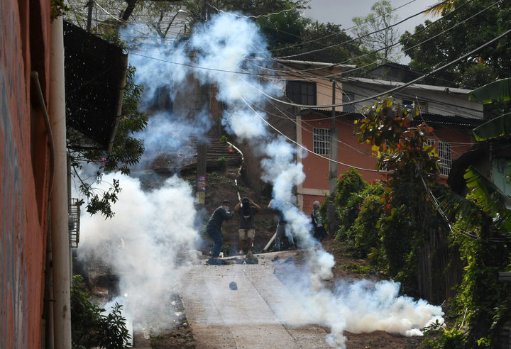 Supporters of presidential challenger Salvador Nasralla of the Honduran Opposition Alliance Against the Dictatorship, clash with  police in Tegucigalpa on Saturday, 20 January.