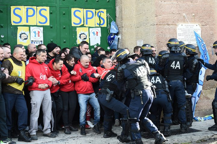 Riot police clash with striking prison guards blocking the access to the Baumettes prison on Monday 22 January in Marseille.