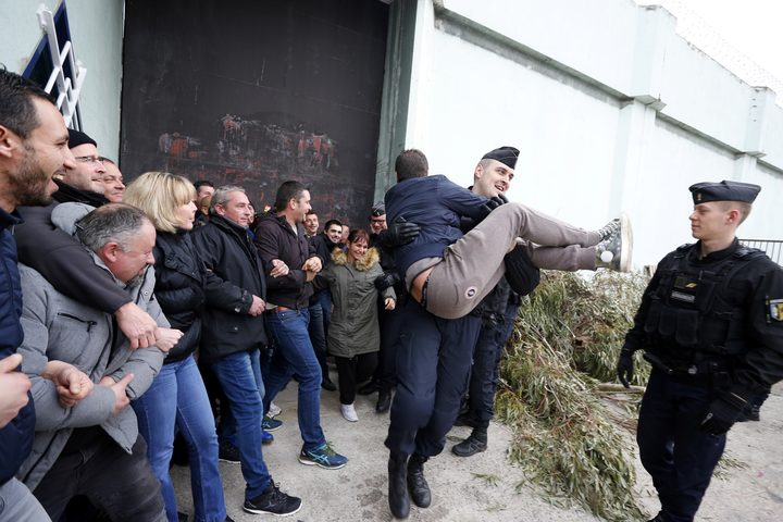 Riot police evacuate striking prison guards blocking the access to Borgo prison  on Corsica island on Monday 22 January, 2018.