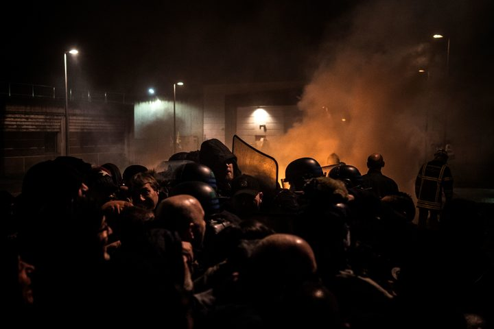 Striking prison guards clash with riot police in front of Villefranche-sur-Saone prison on Monday 22 January 2018.