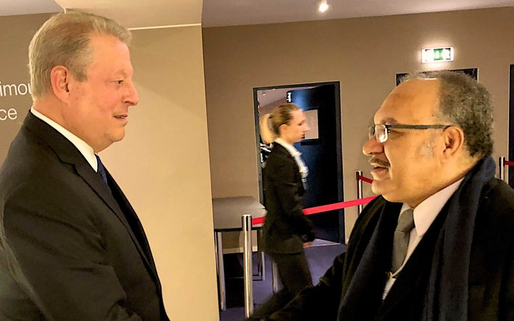 Prime Minister Peter O'Neill (right) meets former United States Vice President, and Chairman and Co-Founder of the Generation Investment Management, Al Gore, in Davos ahead of their discussion on climate change at the World Economic Forum