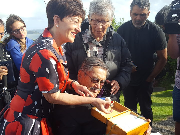 Governor-General Dame Patsy Reddy with Ngāti Hine elder Raumoa Kawiti examining the seal given to his tupuna by Queen Victoria.