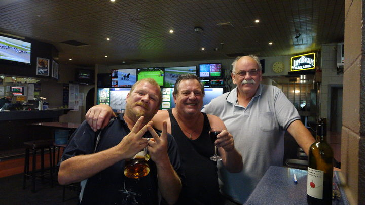 Pub patrons, from left, Pudgey, Lance and Phil, found their cool spot yesterday in Wainuiomata's sweltering heat.