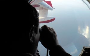 Malaysian maritime personnel searching for the missing Malaysia Airlines plane off the northeastern coast of Malaysia.