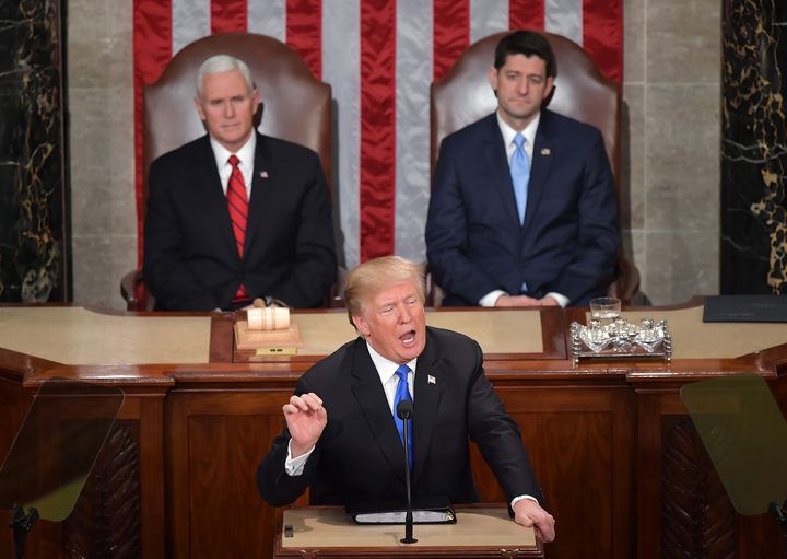 US Vice President Mike Pence (L) and Speaker of the House Paul Ryan listen as US President Donald Trump gives his State of the Union address.