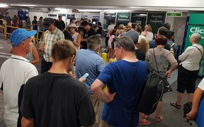 Lengthy queues at all pay stations after Saturday's waterfront concert caused AT to raise barrier arms and let visitors leave without paying.