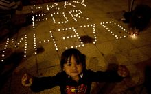 A Malaysian child during a vigil for missing Malaysia Airlines passengers in Kuala Lumpur.