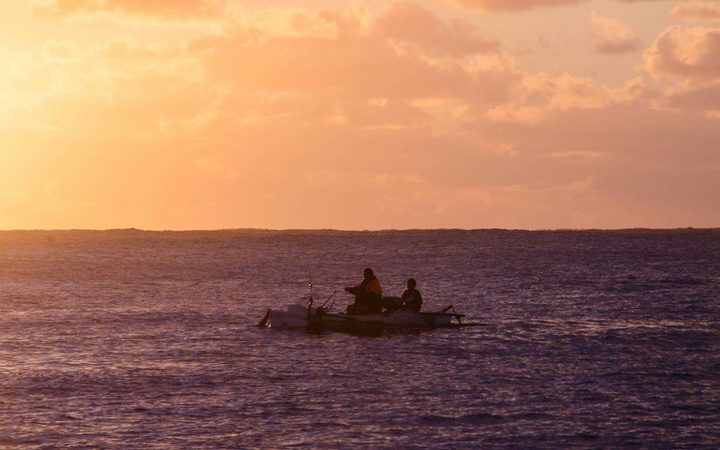 Fishing at sunset off Mangaia, Cook Islands