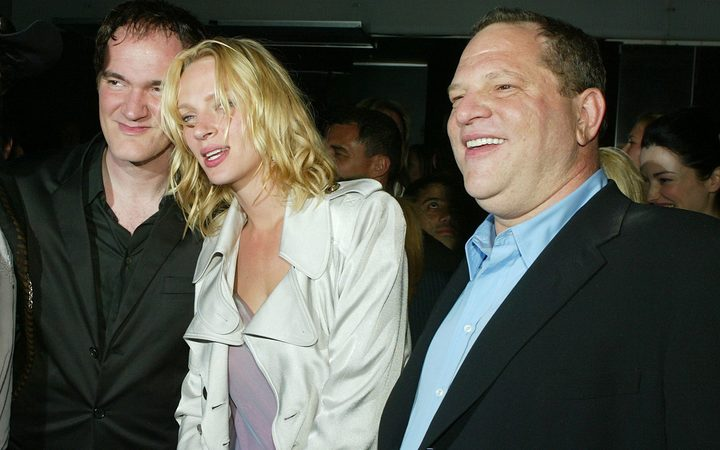 Director Quentin Tarantino (L), actress Uma Thurman, and Harvey Weinstein (R) at the after-party for Kill Bill Vol. 2 in 2004.