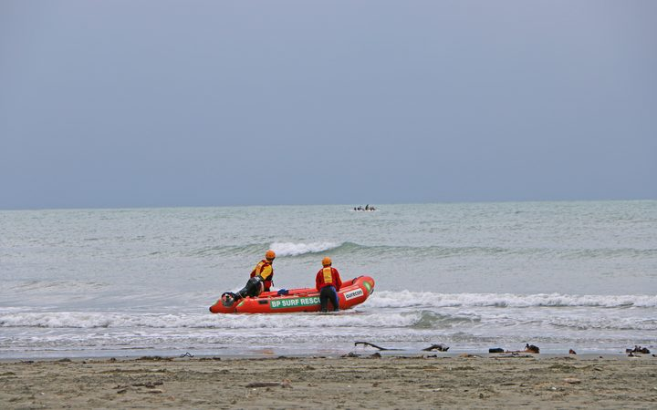 Surf life savers helping with search in Sumner.