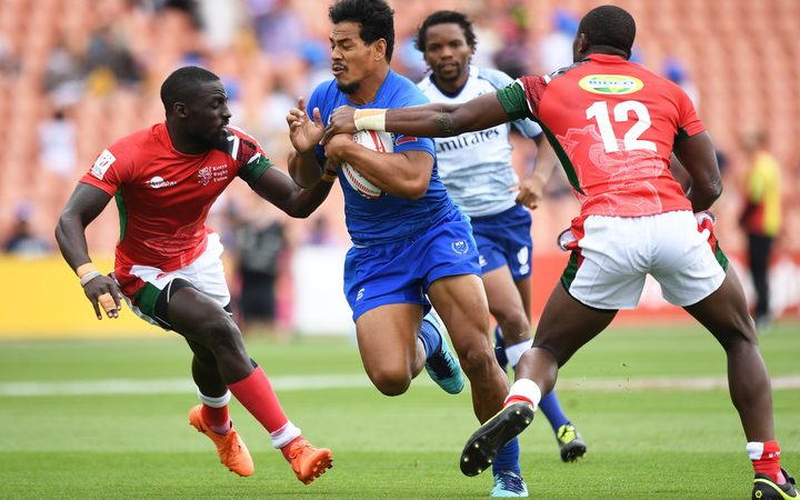 Samoa's Tofatu Solia challenges the Kenyan defence.