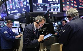 Traders work on the floor of the New York Stock Exchange for Tuesday trading.