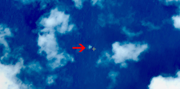 "A satellite image taken from space illustrating an object in a ""suspected crash sea area"" in the South China Sea on 9 March."