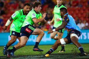 Joshua McKay of the Highlanders runs at Jed Holloway of the Waratahs during the Global Tens Tournament