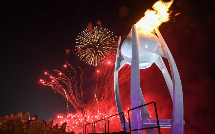 The Olympic flame is lit to a background of fireworks at the Pyeongchang 2018 Winter Olympic Games opening ceremony.
