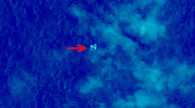 "A satellite image taken from space, illustrating objects in a ""suspected crash sea area"" in the South China Sea on 9 March."