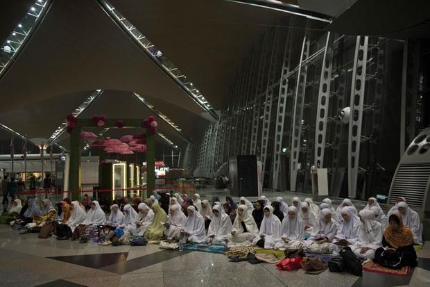 Muslim Malaysians pray at Kuala Lumpur International Airport.